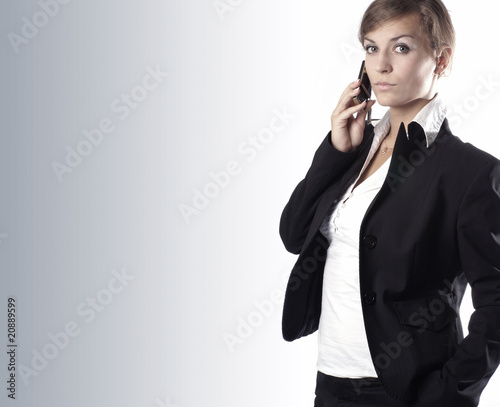 Young attractive businesswoman on cellphone