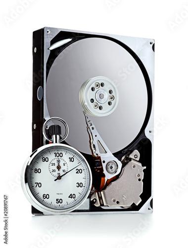 Leinwandbild Motiv Hard disk and stopwatch