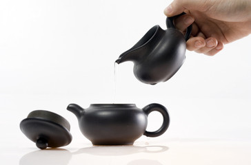 pouring hot water in teapot