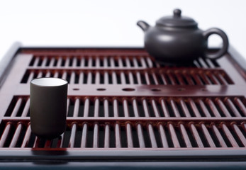 chinese tea ceremony table with teapot and cup