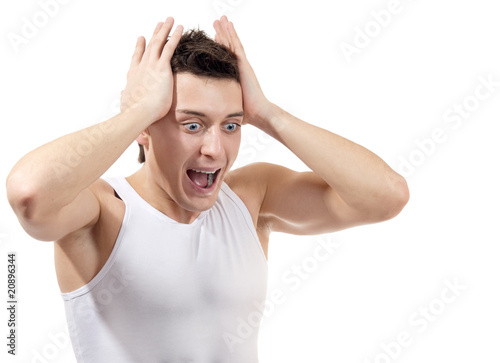 Portrait of scared male, isolated on white