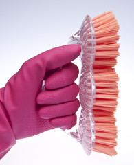 Pink Gloved Hand with Brush