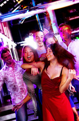 Young adults at a nightclub dancing