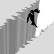 Business man walks risk tightrope over cliff drop danger
