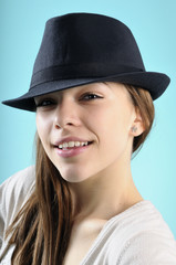 happy girl smiling with black hat