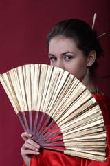 Girl in a kimono with a fun