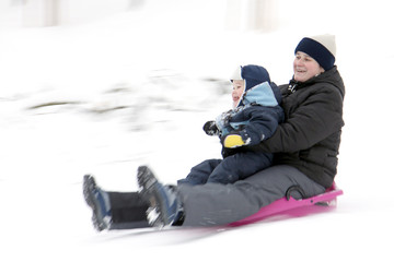 Mother with son on bobsleigh