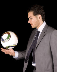 Soccer manager or player with ball