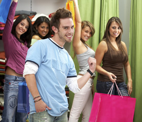 man pointing at female shoppers