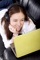 girl on a laptop listening to music