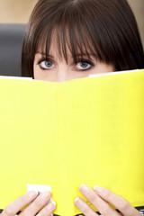 casual girl reading a book