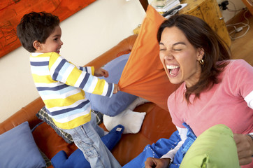 family having fun - pillow fight