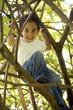 cute boy in a tree