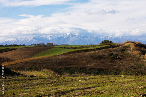 countryside and snowy mountains