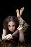 Prehistoric woman with the stone axe poster