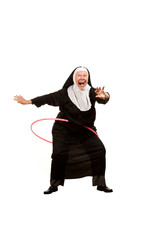 Nun playing with plastic hoop