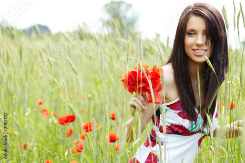 girl running in poppy field