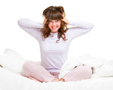 girl in pajamas sitting in bed poster