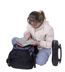 Young woman with backpack and thermos