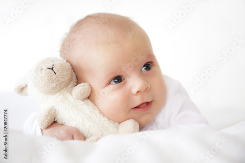 newborn baby with bear on white background