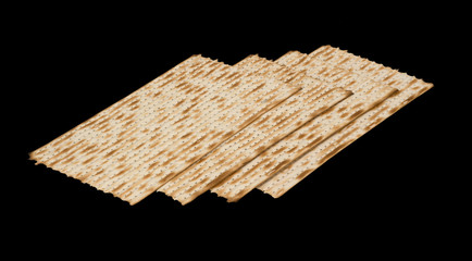 Close up of square matza isolated on black background