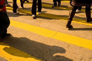 Foots at zebra crossing