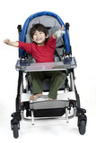 Three year old disabled boy in medical stroller poster