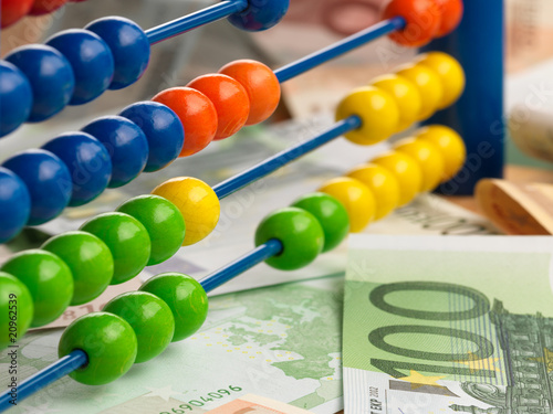 Close up of a colored children Abacus on money fond