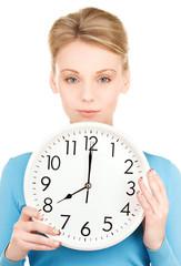 woman holding big clock