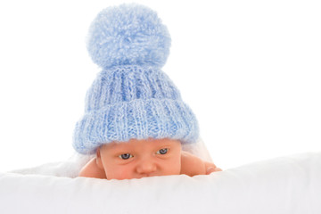 Baby in blue bobble hat