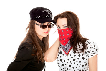 Two beautiful girls portrayed gangsters isolated on white