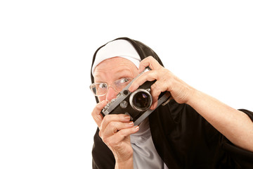 Funny nun with camera