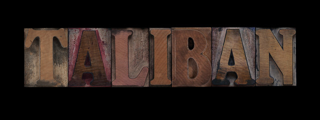 the word Taliban in old letterpress wood type
