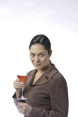 Side view of lady holding a glass of wine