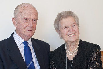 Distinguished old  couple close to ninety in formal attire