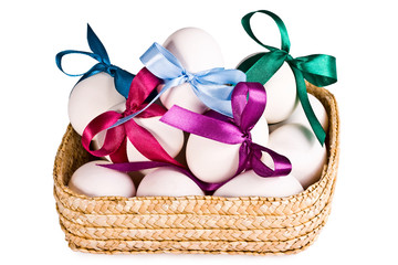 Basket with eggs, on a white