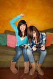 Two girls playing Video game poster