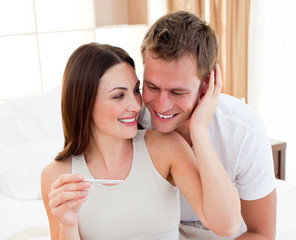 Cheerful couple finding out results of a pregnancy test