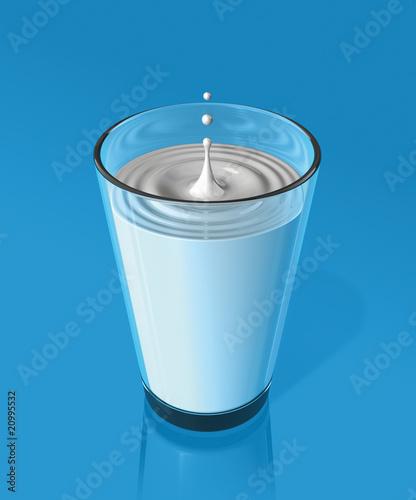 Leinwandbild Motiv drop of milk and ripple in a milk glass