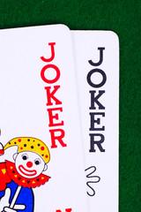 Jokers on green, closeup