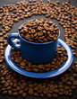 composition of coffee grains and cup with coffee grains