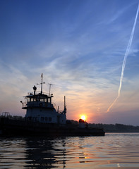 sunset on river and ship