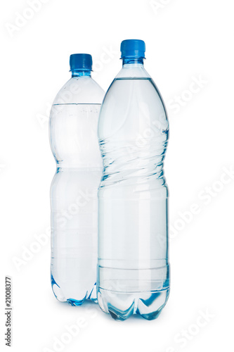 Two blue bottles with water it is isolated on a white background