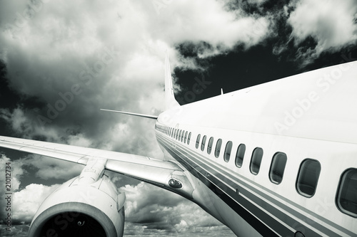 Fototapeta the airplane with the blue sky background.