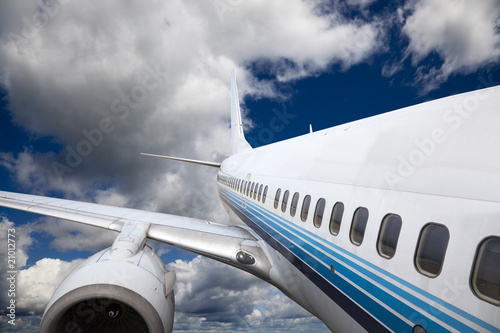 the airplane with the blue sky background.