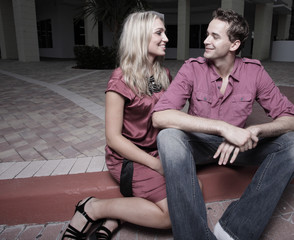 Attractive young couple talking and smiling