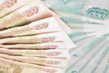 Closeup of 100 and 1000 roubles banknotes poster