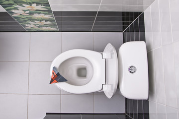 Toilet bowl directly above