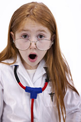 Redhaired girl with doctor's labcoat and glasses