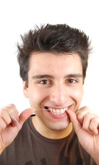 Man flossing his teeth